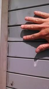 Repairing a Garage Door's Damaged Rolling Steel Doors
